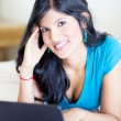 Pretty indian girl using laptop — Stock Photo