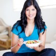 Stock Photo: Young womeating fruit salad