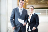 Businessman and businesswoman at airport — Stock Photo