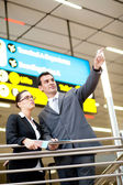 Business travellers in airport — Stock Photo