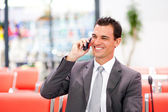 Happy businessman talking on cell phone — Stock Photo