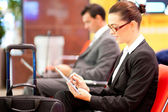 Businesswoman using tablet at airport — Stock Photo
