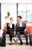 Business travellers waiting for flight at airport — Stock Photo