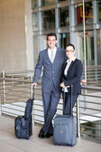 Business travellers at airport — Stock Photo