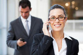 Beautiful young businesswoman on cell phone — Stock Photo