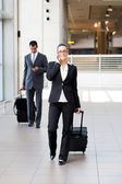 Businesspeople walking in airport — Stock Photo