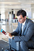 Businessman waiting for flight — Stock Photo