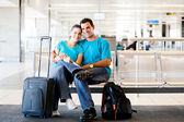 Young couple waiting for flight — Stock Photo