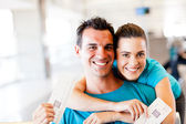 Happy couple at airport — Stock Photo