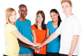 Group of young hands together — Stock Photo