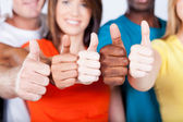 Group of multiracial friends thumbs up — Stock fotografie