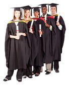 Group of graduates full length portrait — Stock Photo