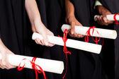 Graduates holding diploma — Stock Photo