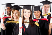 Group of graduates in graduation gown and cap — Stock Photo