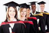 Group of multiracial graduates — Stock Photo
