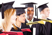 Group of diverse graduates at graduation — Stock Photo