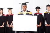 African graduate with white board — Stock Photo