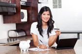 Beautiful indian woman paying credit card bills — Zdjęcie stockowe