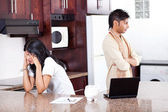 Young indian couple arguing on money in kitchen — Stock Photo