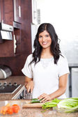 Young indian woman cooking — Stock Photo