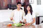 Young indian couple cooking — Stock Photo