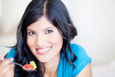 Healthy young woman eating salad — Stock Photo
