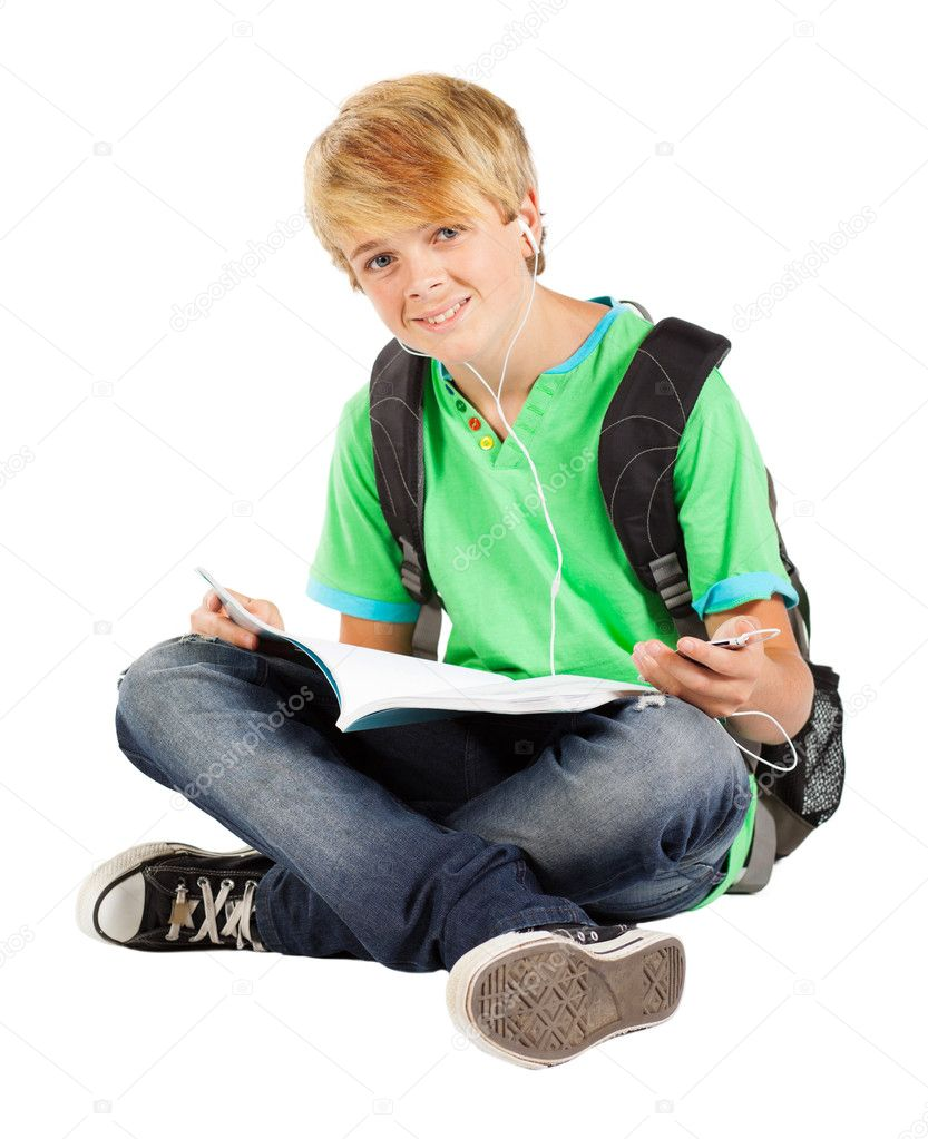 teen boy sitting on floor reading book stock photo michaeljung