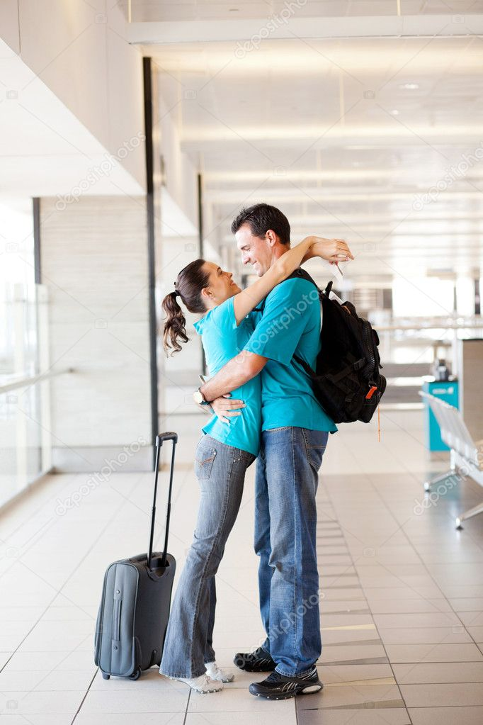 Happy young couple reunion at airport — Stock Photo #10422932