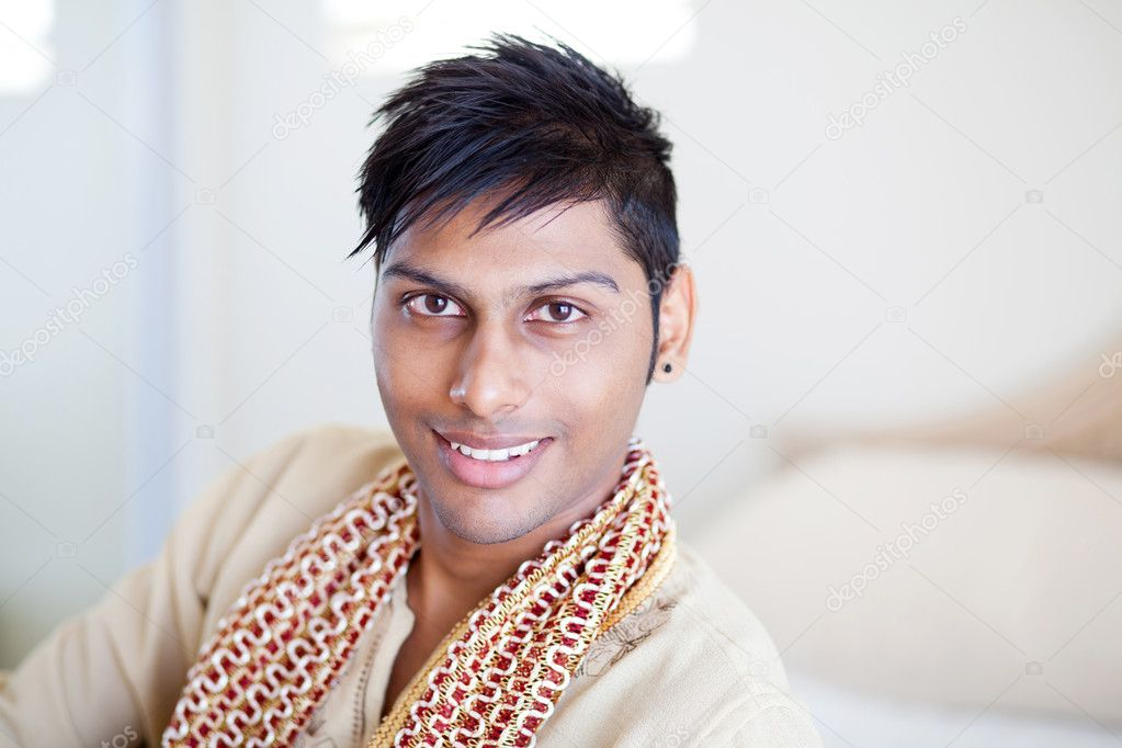 Happy young indian man in traditional clothing — Stock Photo #10423476