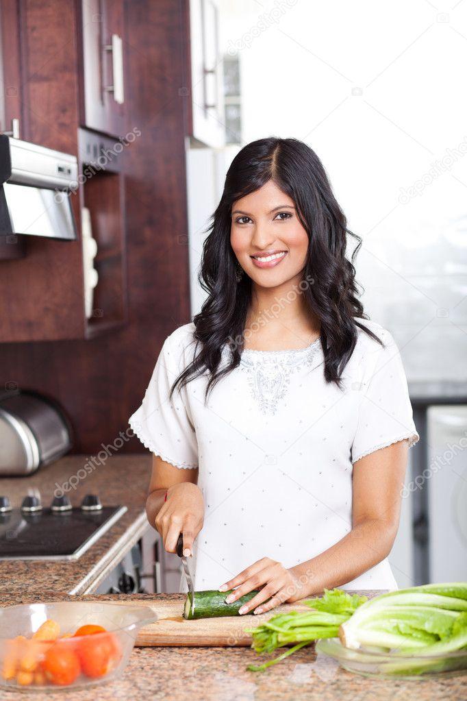 http://static8.depositphotos.com/1011643/1042/i/950/depositphotos_10423503-Young-indian-woman-cooking.jpg Indian Woman Cooking