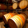 Wine cellar with barrels - Stock Photo