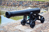 Antique cast iron cannon — Stock Photo