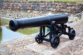 Antique cast iron cannon — Stock Photo
