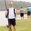 Happy little boy fishing — Stock Photo