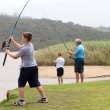 Teen boy casting a fishing rod — Stock Photo