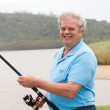 Senior man fishing — Stock Photo
