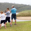 Grandsons fishing with grandpa — Stockfoto