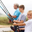 Royalty-Free Stock Photo: Grandsons fishing with grandpa