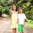 Royalty-Free Stock Photo: Brother and sister walking outdoors