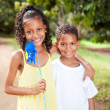 Happy sister and brother outdoors — Stock Photo