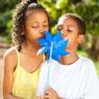 Kids blowing on a pinwheel — Stock Photo