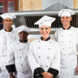 Group of professional chefs in hotel kitchen — Stock Photo