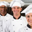 Chefs in kitchen — Stock Photo