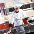 Stock Photo: Professional chef cleaning in commercial kitchen