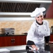Female chef cleaning kitchen — Stock Photo
