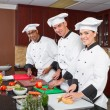 Stock Photo: Professional chefs cooking in commercial kitchen