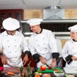 Stock Photo: Professional chefs cooking