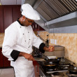 Professional chef cooking in commercial kitchen — Stock Photo