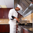 Male chef cooking in kitchen — Stock Photo