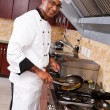 Professional chef cooking in kitchen — Stock Photo